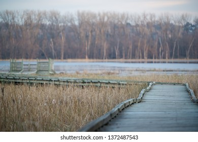 Curved boardwalk walking path to an observation deck - in the fall on the Minnesota River in the Minnesota Valley National Wildlife Refuge