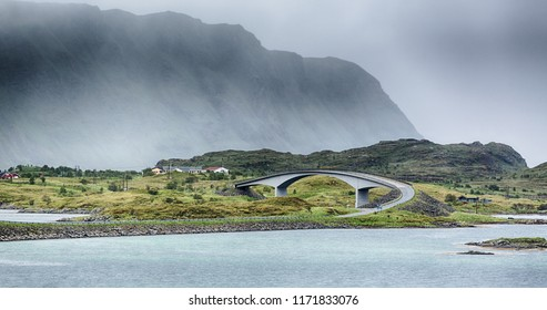 A curved bridge over the Norwegian Sea in a fjord on the Lofoten Islands, Norway.