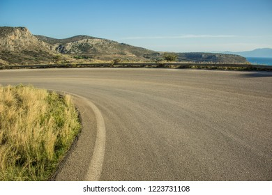 curved car road in rock mountain nature landscape in dry weather summer time Mediterranean sea district