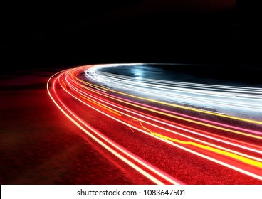 Curved car traffic light trails. 3D illustration