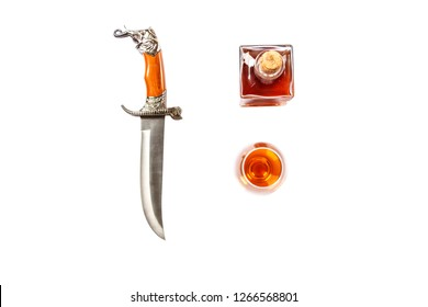 Curved ceremonial dagger knife decanter glass of whiskey isolated on white background. Vintage dagger on white background. Dagger mockup on white.