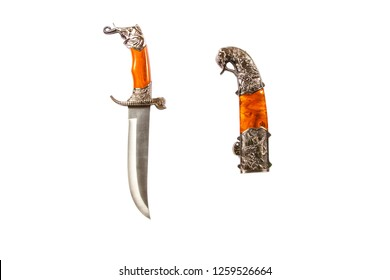 Curved ceremonial dagger knife with a decorative sheath isolated on a white background. Vintage dagger on a white background. Dagger mockup on white.