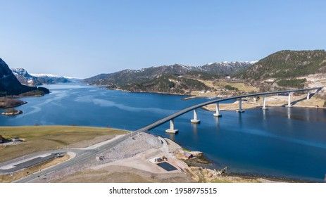 A curved concrete bridge, named Åstfjordbrua, in Norway. A part of the famous Lakseveien. Officially opened in 2021. Snillfjord, Norway,  04.18.2021