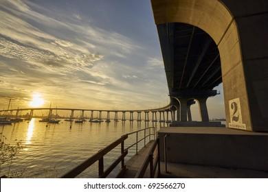 curved Coronado Bridge at sunrise over San Diego Bay