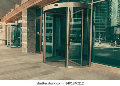 Curved doorway to the office, bank, corporation. Glass and metal doors