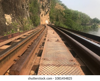 The curved elevated Death railway nearby the cliff in Kanchanaburi in Thailand.