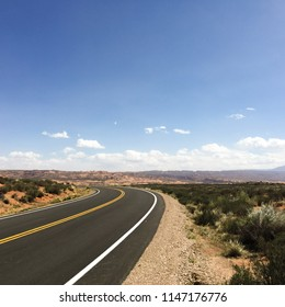 Curved empty highway with desert landscape