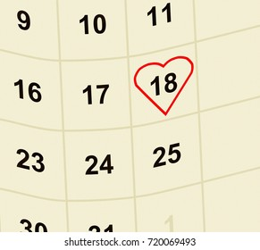 Curved fragment of the calendar with a heart.