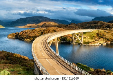 The curved Kylesku Bridge which crosses Loch a' Chàirn Bhàin in the Highlands of Scotland and forms part of the North Coast 500 scenic driving route