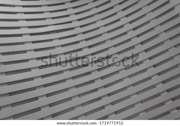 Curved lattice interior background, painted wood layers, horizontal aspect