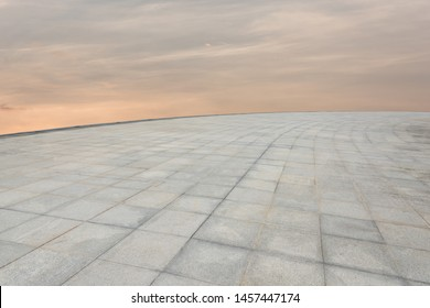 Curved marble tile platform and sky view at the top of the city's tall buildings