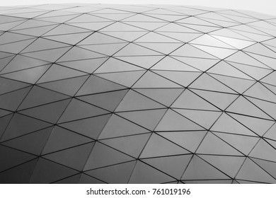 Curved Metal Roof or Ceiling of Dome  Building with Geometric Triangular Steel Structure in Modern Contemporary Architecture Style as abstract architectural industrial background or pattern gray toned