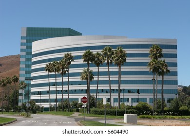 Curved office building with palm trees near San Francisco Airport