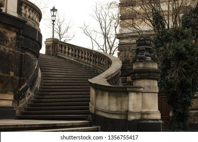 Curved old barocco stairs and balcony in Dresden in grey and beige shades