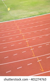 Curved part of running track with corner of football field
