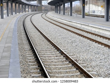 Curved rails at train station entrance