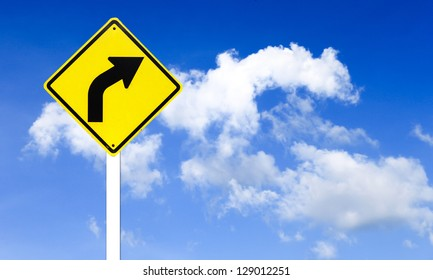 Curved Road Traffic Sign with blue sky