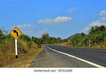 Curved Road Traffic Sign on the road at country side