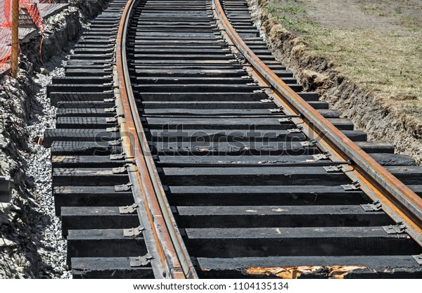 curved-section-railroad-tracks-suburban-