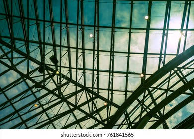 Curved Skylight Glass Roof or Ceiling with Geometric Structure Black Steel in Modern Contemporary Architecture Style as abstract architectural and industrial background or pattern  Blue Vintage Toned