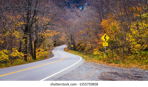 curved Stowe mountain road , Mount Mansfield Vermont at fall landscape