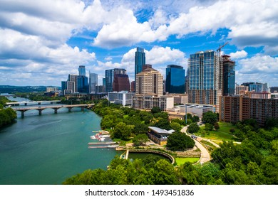 Curved Town Lake and bridges leading up to the Downtown Austin Texas 2019 cityscape skyline summer views