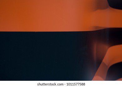Curved wall painted in red and orange stripes