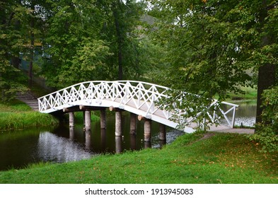 Curved white bridge in the park