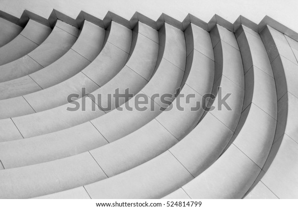 Curvilinear stairs. Top view of modern architecture detail. Refined fragment of contemporary office interior / public building.