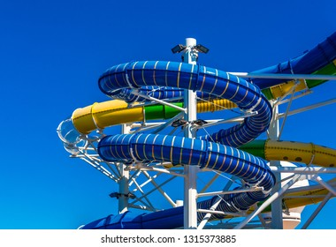 Curving and colorful waterslides on a luxury cruise ship
