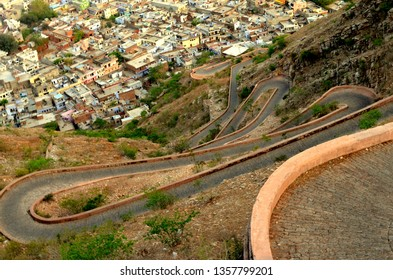 Curving winding road leading to Nahargarh Fort in Jaipur giving the view of the whole city in Rajasthan, India. The fort was constructed as a place of retreat on the summit of the ridge above the city