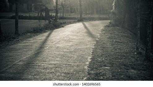 A curvy empty road around an urban area