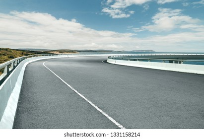 Curvy flyover highway asphalt road with with beautiful landscape , cloudy day .