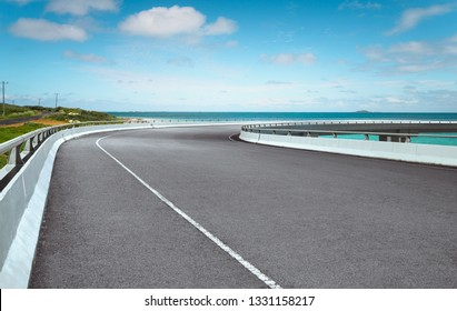 Curvy flyover highway asphalt road with with beautiful landscape , morning scene .