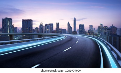 Curvy flyover highway moving forward road with Bangkok cityscape evening scene view . motion blur effect apply