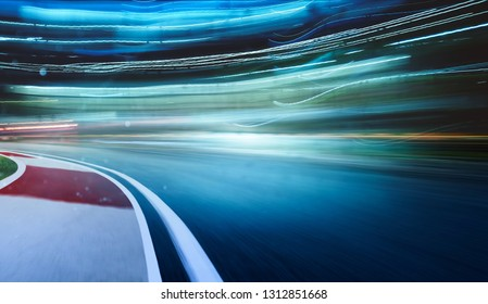 Curvy racing track with motion blur and lighting effect apply .