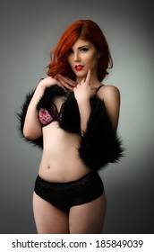Curvy redhead woman posing in sexy lingerie