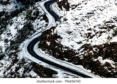 the curvy road on the snowy hills