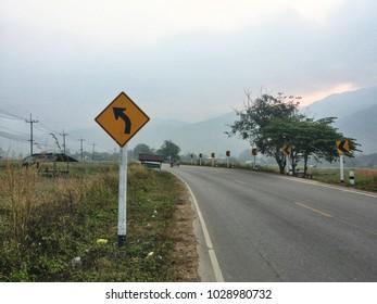 Curvy road sign.
