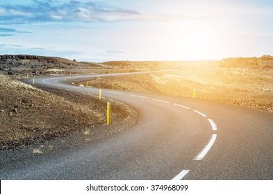 Curvy road in sunset