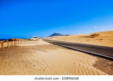 Curvy road through the dunes of Corralejo, Fuerteventura, in the Canary Islands, Spain