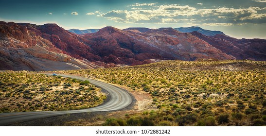 Curvy Road Through Red Rock Formation Mountains. Hiking and Recreation in Nevada National Park