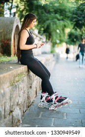 Curvy sexy young woman texting on the street