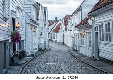 Curvy street with old nice white houses in historical center of Stavanger city, Norway - architecture background