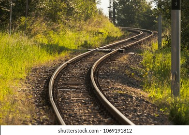 Curvy track, Railroad track making two consecutive opposing curves through a forest.