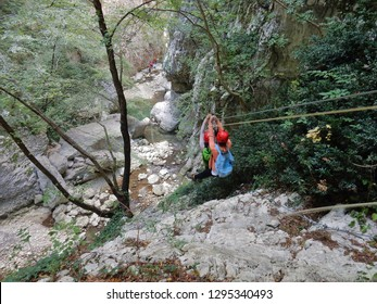 Cusano Mutri, Benevento, Campania, Italy - August 27, 2016: two young hikers as they descend in tandem with the cable car along the adventure path of Caccaviola Gorges
