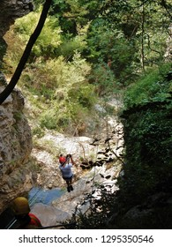 Cusano Mutri, Benevento, Campania, Italy - August 27, 2016: one of the hikers as it descends by cable car on the way Adventure of Caccaviola Gorges