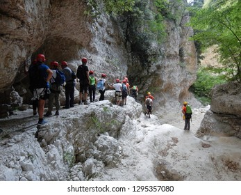 Cusano Mutri, Benevento, Campania, Italy - August 27, 2016: Group of hikers waiting to take the cable car down the narrow gorge adventure trail of Caccaviola Gorges