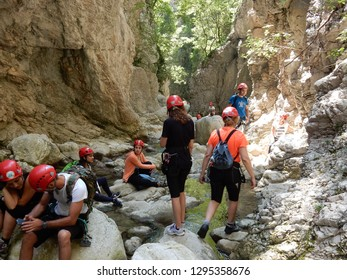 Cusano Mutri, Benevento, Campania, Italy - August 27, 2016: Group of hikers during a short break along the way Adventure of Caccaviola Gorges