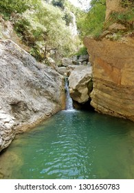 Cusano Mutri, Benevento, Campania, Italy - August 27, 2016: one of the many ponds with waterfall to cross the cable car on the way Adventure of Caccaviola Gorges